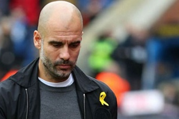 Guardiola fined £20,000 by FA after wearing yellow ribbon