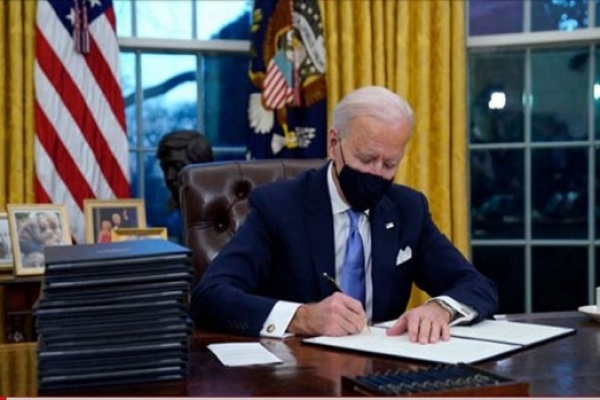 On his first day in office, Biden signs 17 executive orders