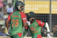 Tamim Iqbal ton,  Mushfiqur Rahim fifty power Tigers